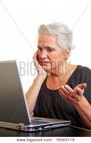 Senior Woman Having Trouble With Her Laptop