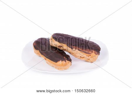Cake eclair isolated on white background. Homemade baking