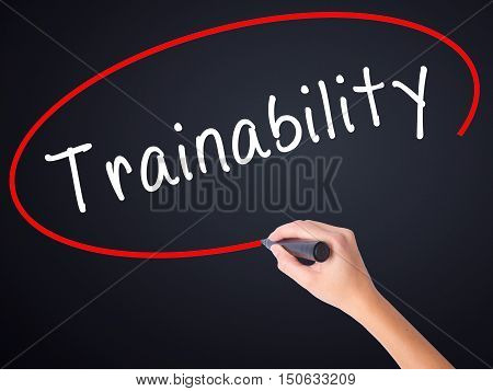 Woman Hand Writing Trainability With A Marker Over Transparent Board