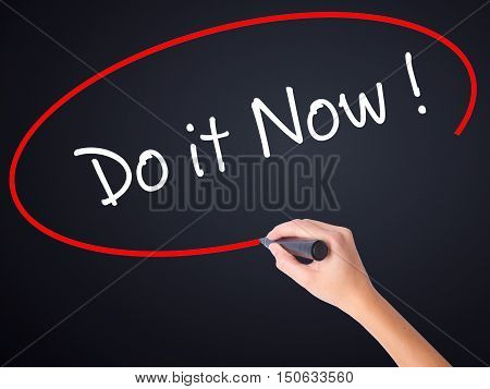 Woman Hand Writing Do It Now With A Marker Over Transparent Board