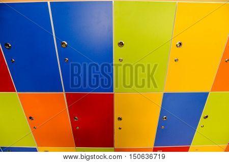 Wooden multi color painted school lockers in hallway