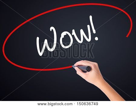Woman Hand Writing Wow! With A Marker Over Transparent Board