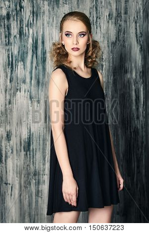 Portrait of a beautiful fashion model with evening make-up posing at studio. Beauty, fashion. Make-up, hairstyle.