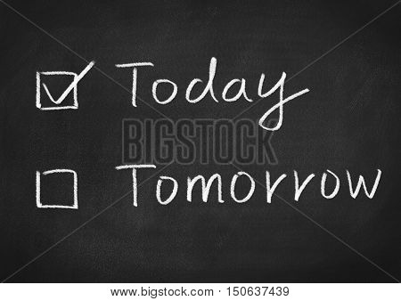 today or tomorrow. text on blackboard background
