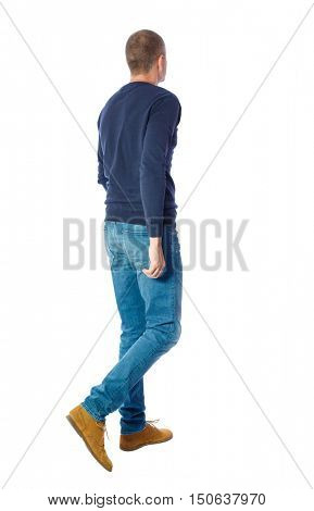 Back view of going  handsome man. walking young guy . Rear view people collection.  backside view of person.  Isolated over white background. A guy in a black sweater goes sideways.