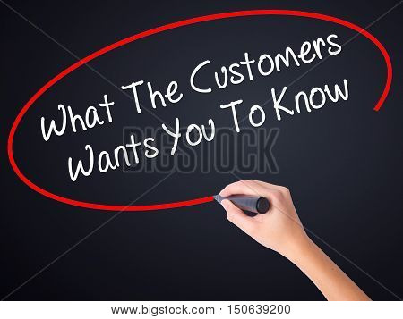 Woman Hand Writing What The Customers Wants You To Know With A Marker Over Transparent Board