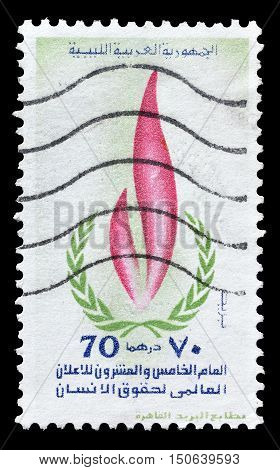 LIBYA - CIRCA 1973 : Cancelled postage stamp printed by Libya, that shows Human rights flame.