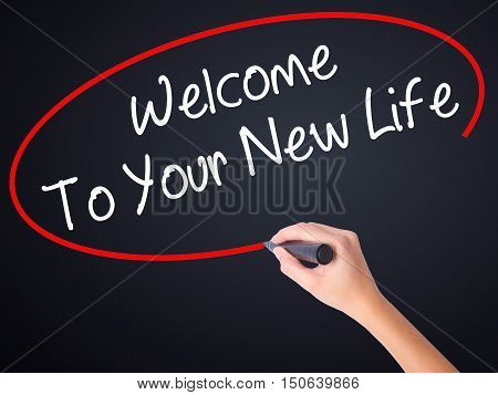 Woman Hand Writing Welcome To Your New Life With A Marker Over Transparent Board