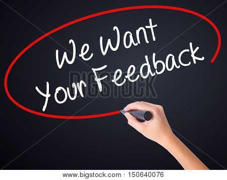 Woman Hand Writing We Want Your Feedback With A Marker Over Transparent Board
