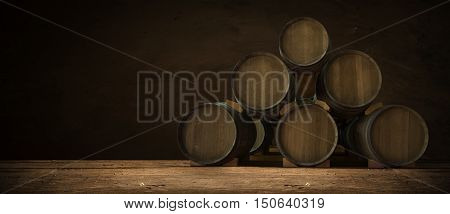 Beer keg with glasses of beer on rural countryside background,