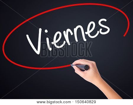 Woman Hand Writing Viernes (friday In Spanish) With A Marker Over Transparent Board