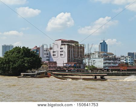 BANGKOK, THAILAND - OCTOBER 2, 2016: Long tail boat serving for tourist to travel around the Chao Phraya river in Bangkok, Thailand.