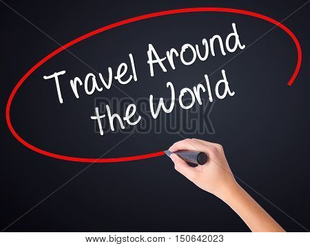 Woman Hand Writing Travel Around The World With A Marker Over Transparent Board