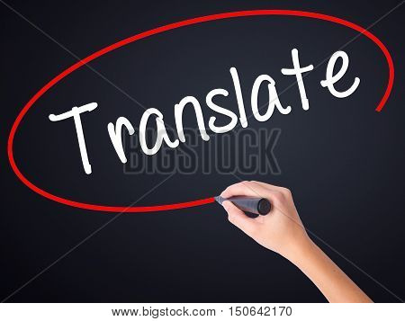 Woman Hand Writing Translate With A Marker Over Transparent Board