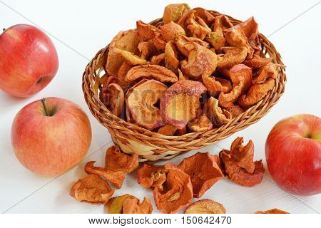Homemade dried apple slices in basket. Dried fruits