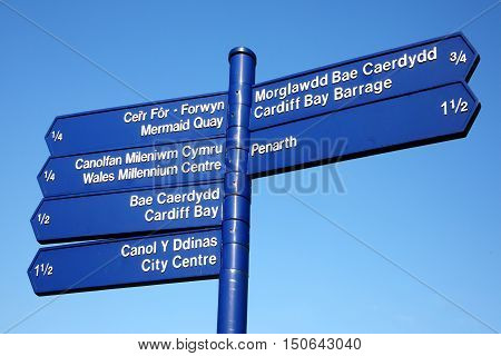Cardiff , Wales street signpost giving directions to some of the cities most popular landmark attractions