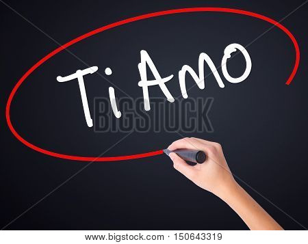 Woman Hand Writing Ti Amo (i Love You In Italian) With A Marker Over Transparent Board .
