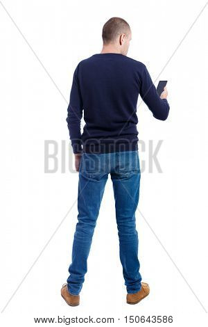 back view of man in suit  talking on mobile phone.    rear view people collection. Isolated over white background. backside view of person. Man in black sweater looking to the smartphone screen.