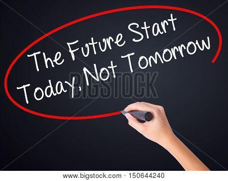 Woman Hand Writing The Future Start Today, Not Tomorrow With A Marker Over Transparent Board .