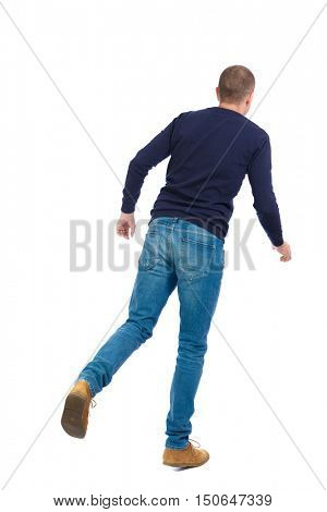 Back view of going  handsome man. walking young guy . Rear view people collection.  backside view of person.  Isolated over white background. Man in warm jacket standing on one leg.