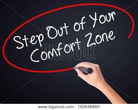 Woman Hand Writing  Step Out Of Your Comfort Zone With A Marker Over Transparent Board .