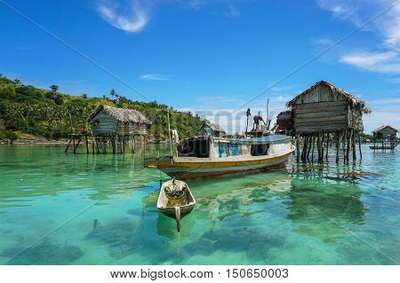 The traditional sea gypsy water village with the unique boat in Bodgaya Island at Semporna,Sabah,Borneo,Malaysia.One of the main attraction of Semporna with clear blue water,sand & palm trees.