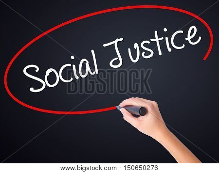Woman Hand Writing Social Justice With A Marker Over Transparent Board