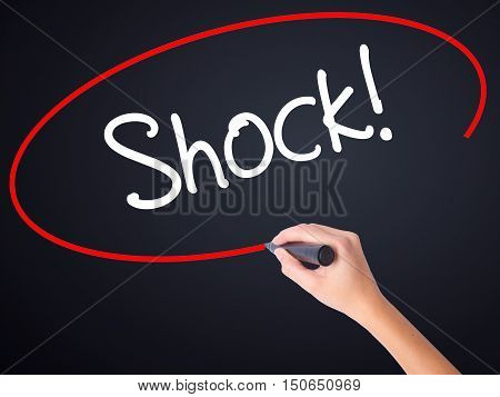 Woman Hand Writing Shock! With A Marker Over Transparent Board