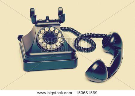 Isolated old black vintage telephone