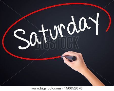 Woman Hand Writing Saturday With A Marker Over Transparent Board
