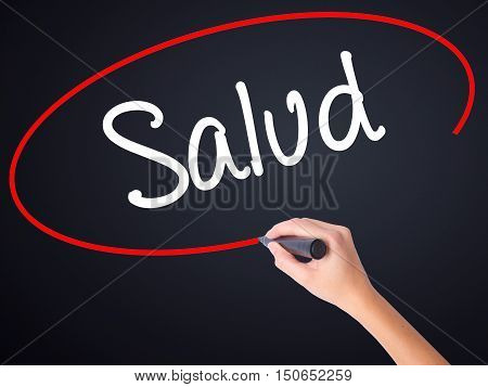 Woman Hand Writing Salud (health In Spanish) With A Marker Over Transparent Board .