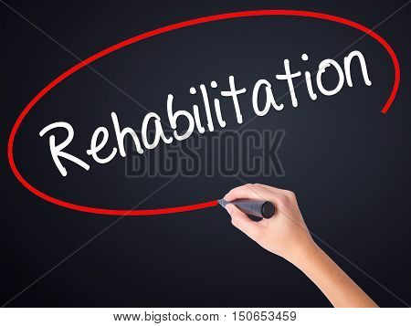 Woman Hand Writing Rehabilitation With A Marker Over Transparent Board