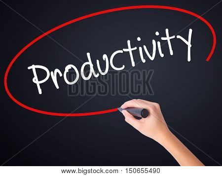 Woman Hand Writing  Productivity With A Marker Over Transparent Board