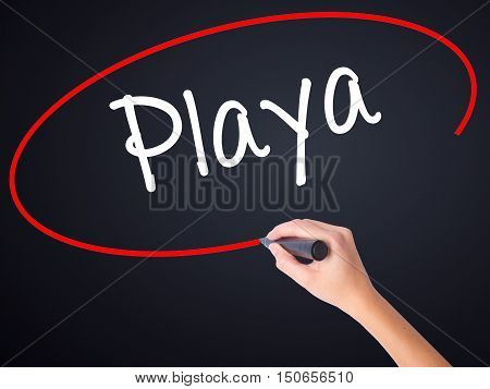 Woman Hand Writing Playa (beach In Spanish)  With A Marker Over Transparent Board