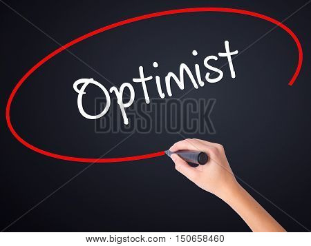 Woman Hand Writing Optimist  With A Marker Over Transparent Board