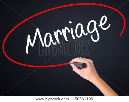 Woman Hand Writing Marriage With A Marker Over Transparent Board