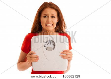 Woman With Scale Unhappy With Her Weight Gesturing Sadness And Worry Isolated Over White Background