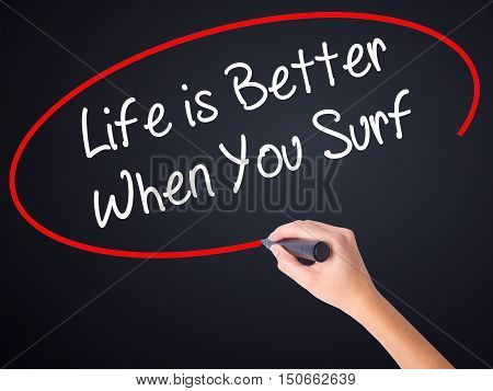 Woman Hand Writing Life Is Better When You Surf With A Marker Over Transparent Board .