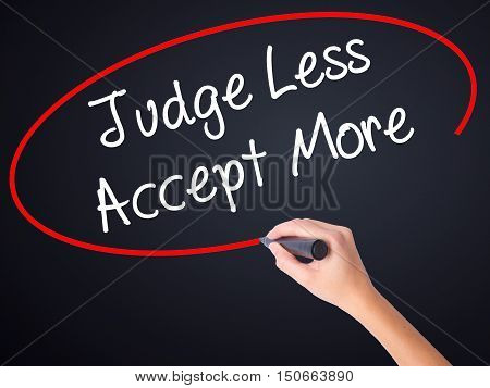 Woman Hand Writing Judge Less Accept More With A Marker Over Transparent Board