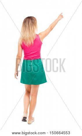 back view of pointing walking  woman. going girl pointing.  backside view of person.  Rear view people collection. Isolated over white background. Girl in a green skirt went off showing thumb up.