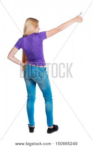 Back view of  pointing woman. beautiful girl. Rear view people collection.  backside view of person.  Isolated over white background. Long-haired blonde in the purple shirt is pointing sideways.