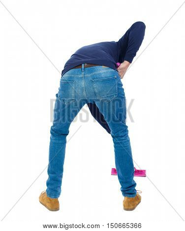 Back view of a man washing floor mop. He is busy cleaning. Rear view people collection.  backside view of person.  Isolated over white background. Man in warm jacket red mop washes the floor.