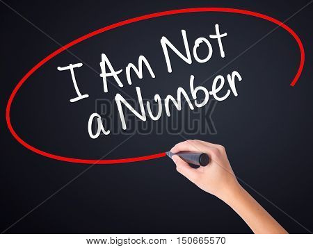 Woman Hand Writing I Am Not A Number With A Marker Over Transparent Board