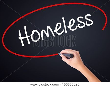 Woman Hand Writing Homeless With A Marker Over Transparent Board .