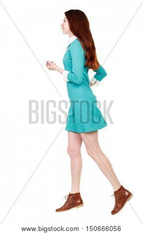 back view of running  woman. beautiful girl in motion. backside view of person.  Rear view people collection. Isolated over white background. A girl in a short blue dress runs away in the side.