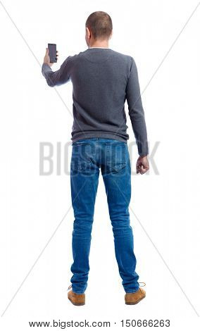 back view of man in suit  talking on mobile phone.    rear view people collection. Isolated over white background. backside view of person. A guy in a gray sweater looking in the phone.