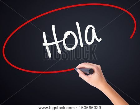 Woman Hand Writing Hola  (hello In Spanish) With A Marker Over Transparent Board