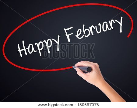 Woman Hand Writing Happy February With A Marker Over Transparent Board