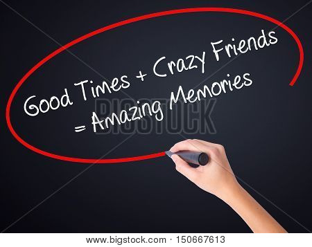 Woman Hand Writing Good Times + Crazy Friends = Amazing Memories With A Marker Over Transparent Boar