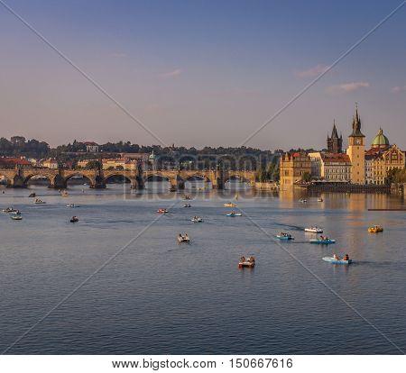 River Vltava Prague And Tourist Boats In The Golden Evening Sun